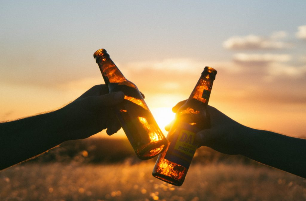 Celebrating fixing your credit score in the sunset. Relax knowing your bad credit has now become better with a beer.